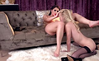 Fragile blonde teen dominated by curvy brunette in stockings