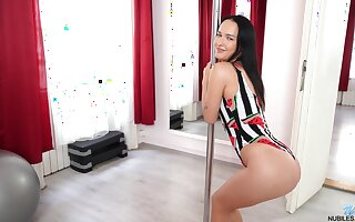 Torrid solo girl Sasha Sparrow dances relative to the pole with the addition of teases
