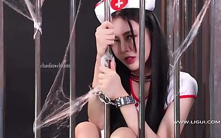 Gird a beautiful  china woman in a cage bdsm - Big tits