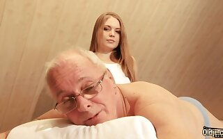 Luring hot young masseuse is quite busy with riding cock of old pervert