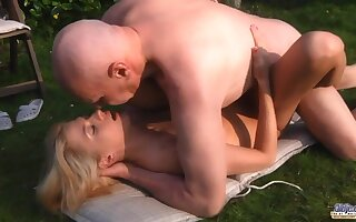 Pensioner fucks pretty young blonde after blowjob connected with the garden