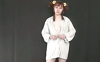Pigtailed ginger nympho flashes her naff pale tits and her pissing show