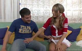 Cute pigtailed cheerleader Natalia Rossi gives a blowjob and rides flannel