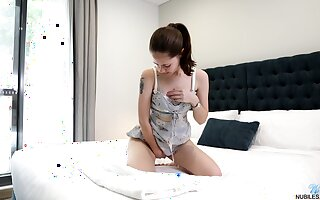 Svelte girl Eva May gets rid of her lacy lingerie to work on wet pussy